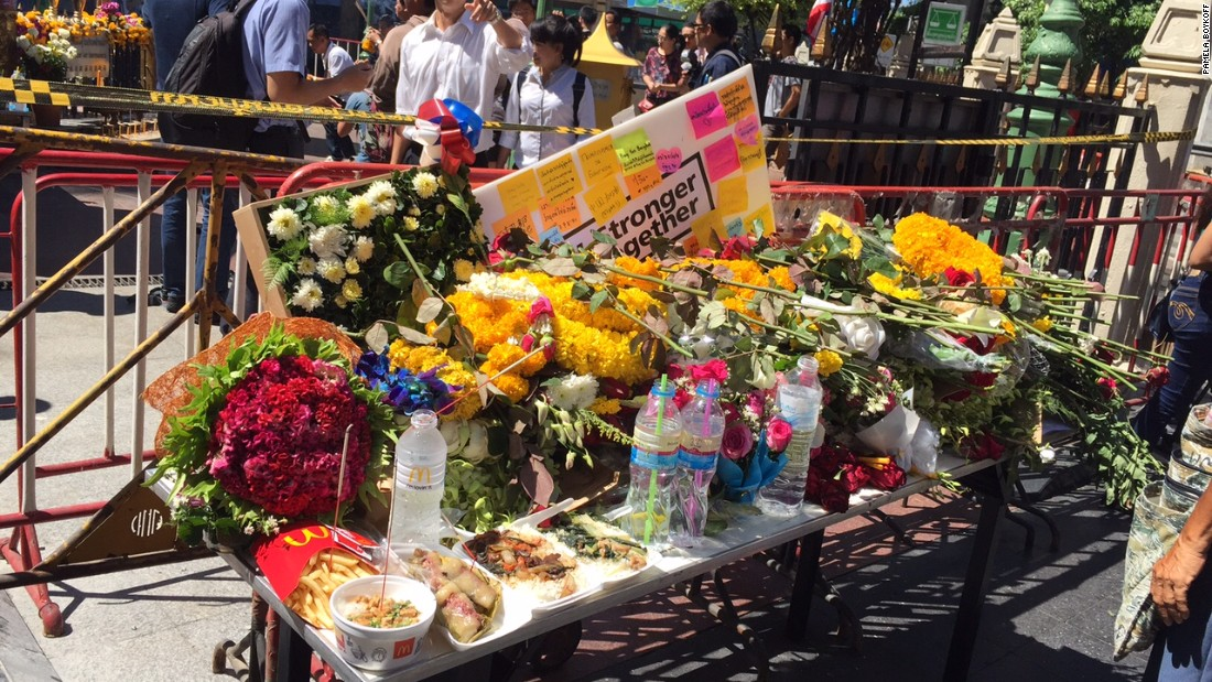 Messages and flowers for victims killed in the bomb blast are displayed outside the shrine.