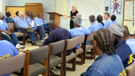 Collette Carroll leads a group of San Quentin inmates in a session on life skills and accountability as part of her rehabilitation program.