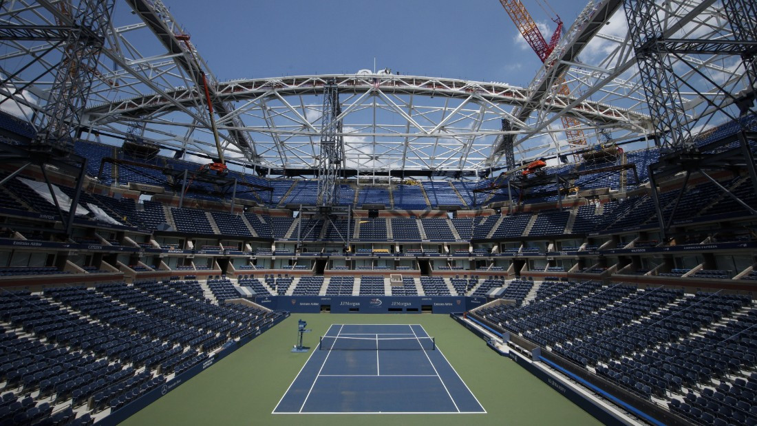 General view of Arthur Ashe Stadium while the final piece of steel for the roof structure it's installed at the USTA Billie Jean King National Tennis Center in New York City on June 10, 2015. AFP PHOTO/ Kena Betancur        (Photo credit should read KENA BETANCUR/AFP/Getty Images)
