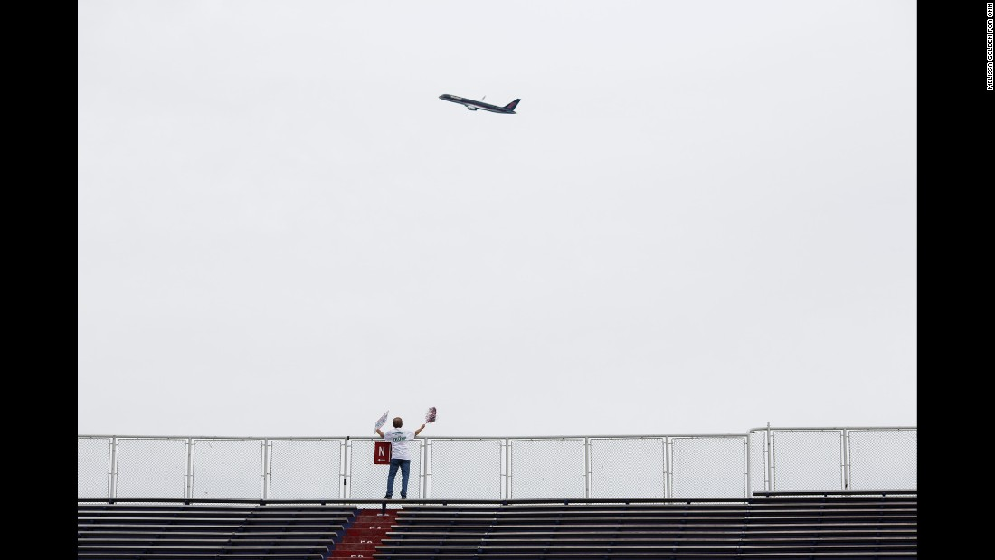 Trump's 757 plane circles the venue as he arrives. Trump flew by the stadium in his private jet shortly before 6 p.m., doing a loop around the arena before landing. The fly-by was announced over the stadium's loudspeaker to cheers.