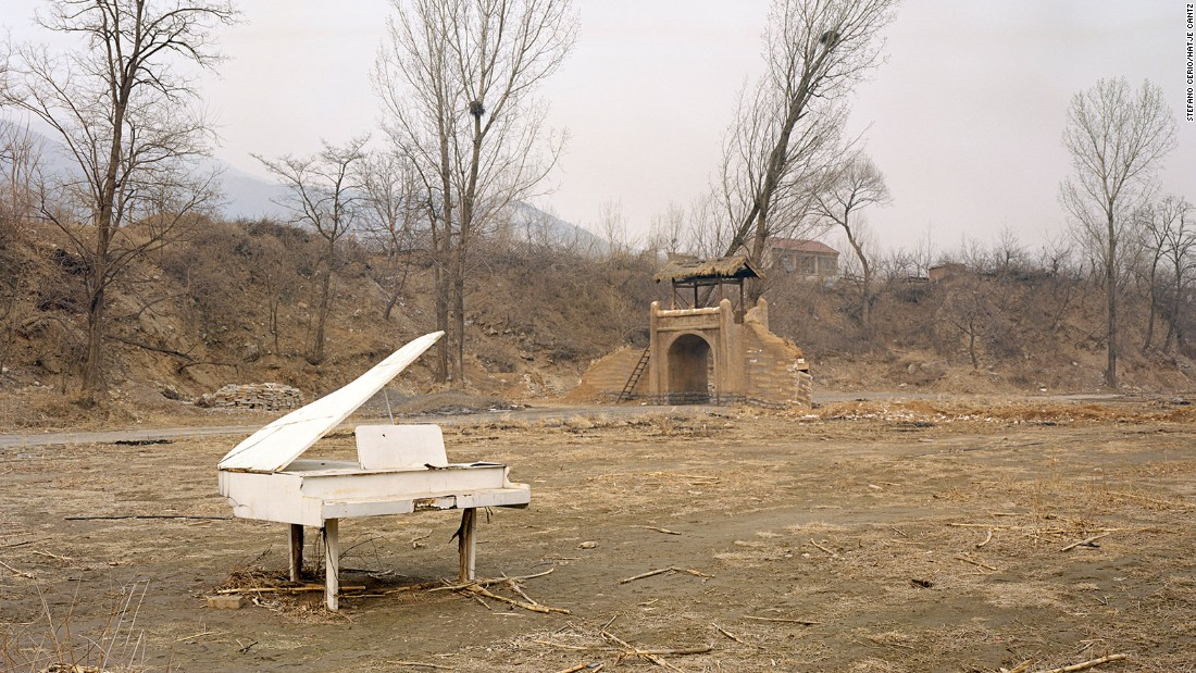 This fake baby grand piano has seen happier days. Cast aside in Huairou, a district nestled in northern Beijing, the piano is an old set piece used for wedding photography. In China, wedding photos are taken before couples tie the knot. Often these photos involve elaborate, fantasy scenes and multiple dresses.
