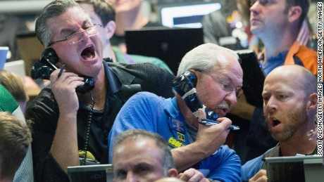 CHICAGO, IL - AUGUST 24:  A traders fill orders in the Standard & Poor's 500 stock index options pit at the Chicago Board Options Exchange (CBOE) on August 24, 2015 in Chicago, Illinois. Uncertainty among traders after big losses in the Asian markets caused a sharp drop in the S&P at the open.  (Photo by Scott Olson/Getty Images)