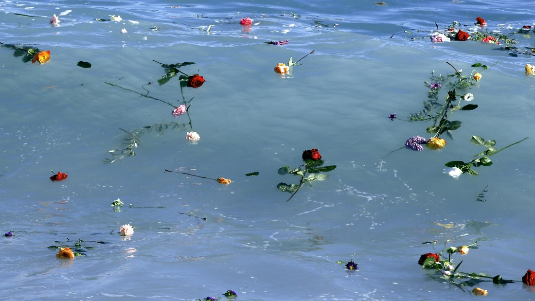 Flowers float in the sea after they were thrown into the Mediterranean in honor of the migrants lost making the perilous journey across the sea, on April 28, 2015 in Nice, southeastern France. Nearly 5,000 migrants have drowned in waters between Libya and Italy since the start of 2014 with the death rate accelerating significantly since a major Italian search-and-rescue operation was suspended late last year because of cost pressures and opposition from other EU states who said it only encouraged migrants to attempt the journey.