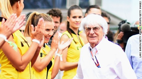 BUDAPEST, HUNGARY - JULY 26:  F1 supremo Bernie Ecclestone jokes with a grid girl during the drivers' parade before the Formula One Grand Prix of Hungary at Hungaroring on July 26, 2015 in Budapest, Hungary.  (Photo by Lars Baron/Getty Images)