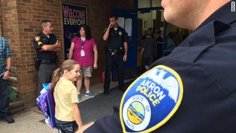 Daughter of fallen officer gets police escort to school