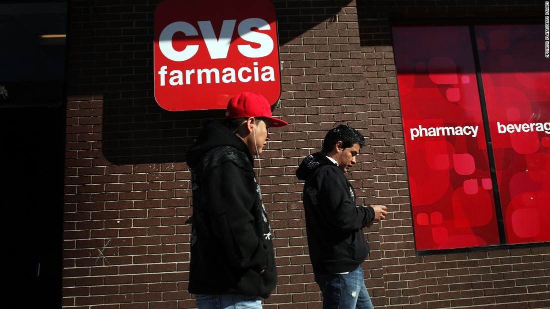 """Hispanic residents walk by a bilingual sign for a CVS pharmacy in Union City, New Jersey.  A July report by the Spain-based nonprofit Instituto Cervantes indicates that the United States is the world's <a href=""""http://www.cnn.com/2015/07/01/us/spanish-speakers-united-states-spain/index.html"""">second-largest Spanish-speaking country</a>. Only Mexico has more Spanish speakers."""