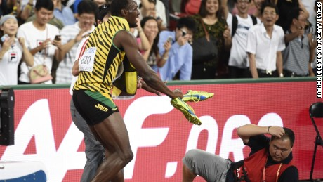 """Jamaica's Usain Bolt reacts after a cameraman on a segway crashed into him in the final of the men's 200 metres athletics event at the 2015 IAAF World Championships at the """"Bird's Nest"""" National Stadium in Beijing on August 27, 2015. AFP PHOTO / FRANCK FIFE        (Photo credit should read FRANCK FIFE/AFP/Getty Images)"""