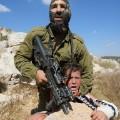 02 Israeli soldier Palestinian boy 0831015