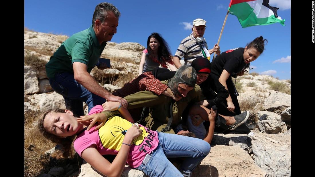 http://i2.cdn.turner.com/cnnnext/dam/assets/150830123648-08-israeli-soldier-palestinian-boy---restricted-super-169.jpg