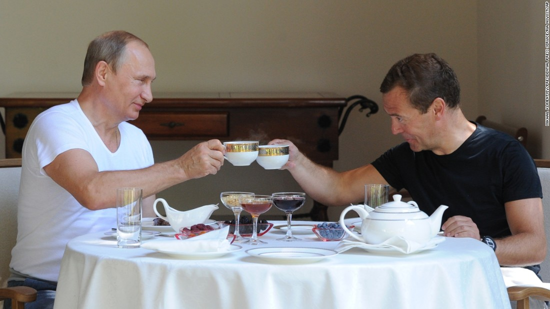Putin, left, and Prime Minister Dmitry Medvedev jokingly toast at a lunch during a meeting at the Black Sea resort in Sochi, Russia, on Sunday, August 30.