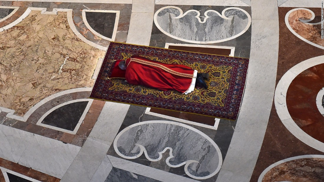 The Pope prays face down on the floor of St. Peter's Basilica during Good Friday celebrations at the Vatican on Friday, April 3.