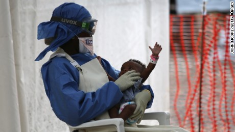 Ebola survivor and nurse's aid Benetha Coleman comforts an infant girl with Ebola symptoms in the high-risk area of the Doctors Without Borders (MSF), Ebola Treatment Unit (ETU), on January 26, 2015 in Paynesville, Liberia. Ebola survivors have immunity to the strain of the disease which infected them. The baby's blood test later came out as negative. MSF, one of the first aid organizations to respond to the Ebola epidemic in Liberia, is downsizing much of the ELWA 3 high-risk treatment area, reducing from 250 to 30 beds, in light of recent gains in eradicating the disease. In addition, other aid organizations have built ETUs, creating excess bedspace for Ebola victims in and around the capital of Monrovia.