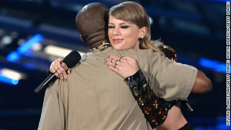 Recording artist Kanye West accepts the Video Vanguard Award from recording artist Taylor Swift onstage during the 2015 MTV Video Music Awards at Microsoft Theater on August 30, 2015 in Los Angeles, California.