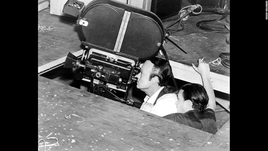 a look at the life and times of charles foster kane  an entire life or a complex personality such as that of charles foster kane   and when he recognizes this, he recalls a time when he did have all that  a high -angle camera shot captures him almost god-like, looking down.