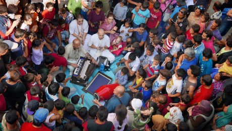 Hare Krishna performing to Syrian refugee kids outside Keleti Railway Station in Budapest, Hungary on Tuesday, September 2.