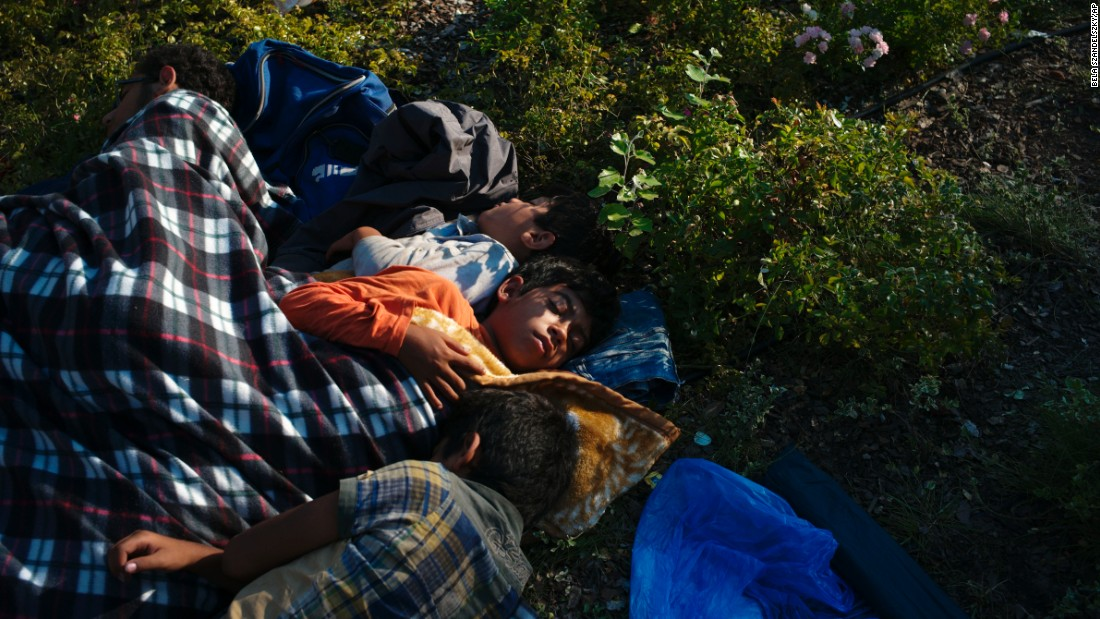 Refugee children sleep near a railway station in Budapest, Hungary.
