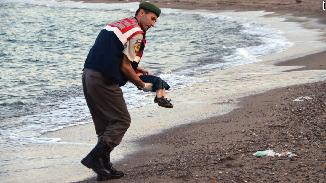 An officer in Bodrum, Turkey, carries Aylan's body away from the shore on September 2. The child was one of 12 refugees who drowned during a failed attempt to sail to the Greek island of Kos.