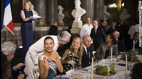 (From L) Miss France 2015 Camille Cerf, French chef Alain Ducasse speaking to US ambassador to France Jane D. Hartley, French Foreign Affairs Minister Laurent Fabius, and President of the Palace of Versailles, Catherine Pegard (Rear L) attend on March 19, 2015 the Gout de France/Good France dinner at the Versailles castle. AFP PHOTO / MARTIN BUREAU        (Photo credit should read MARTIN BUREAU/AFP/Getty Images)