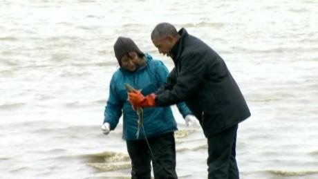 Salmon spawns on Obama while fishing in Alaska
