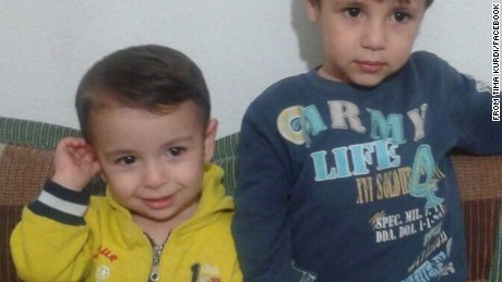 CNN now has a photo of 3-year-old Aylan Kurdi smiling in a little yellow jacket alongside his big brother Galip. Just the way family members and activists want two of the tiniest victims of the refugee tragedy remembered.
