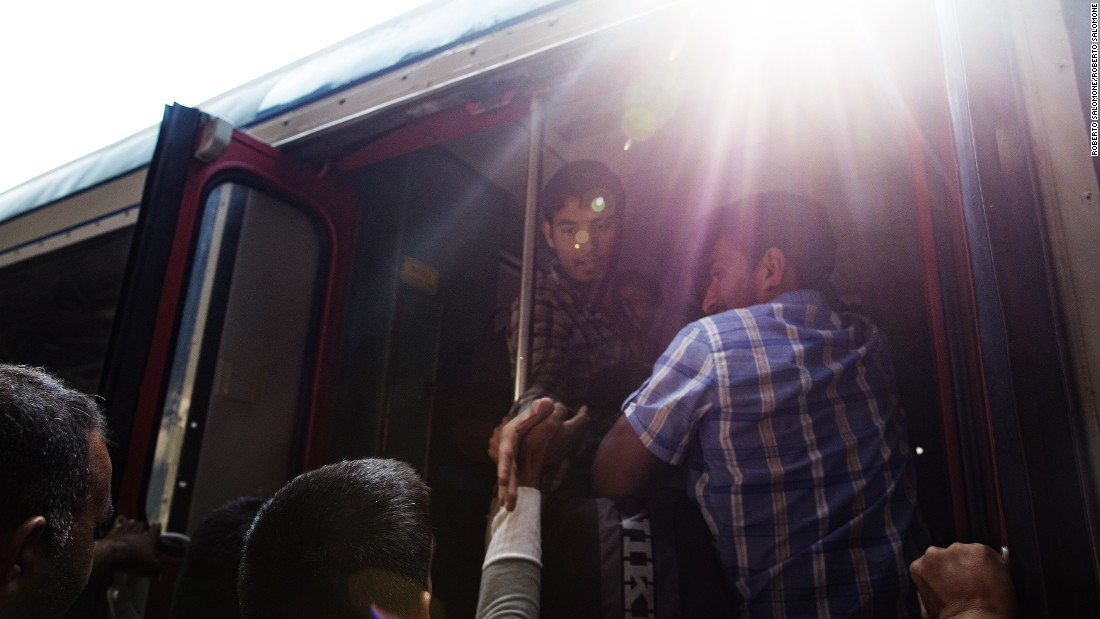 Migrants try to board trains in Budapest.