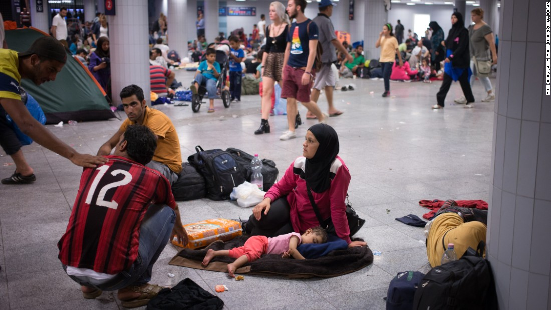 "While European leaders struggle to come up with a coherent plan, the men, women and children caught up in the crisis continue to suffer. On Wednesday, some refugees in Budapest held up scraps of paper: ""Help Syrians,"" they read. ""Babies are tired."""