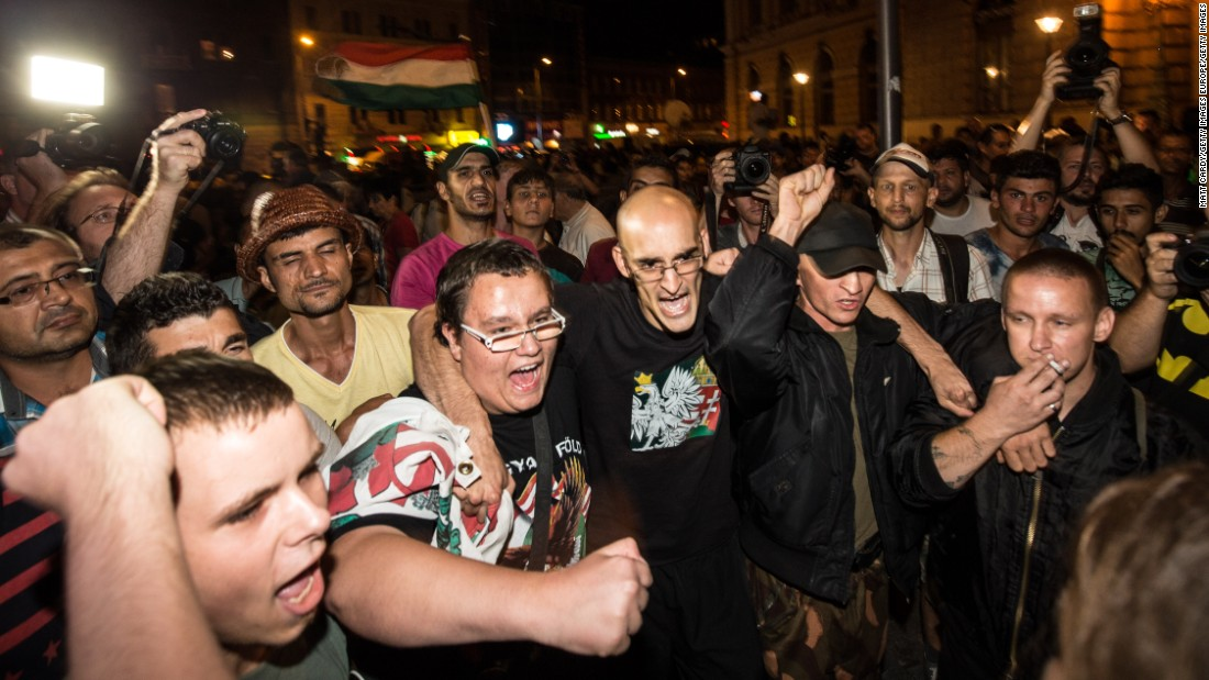 Hungarian nationalists protest as migrants gather in front of Keleti station on September 2.