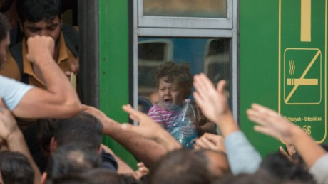 BUDAPEST, HUNGARY - SEPTEMBER 03:  Migrants board trains in Keleti station after it was reopened this morning in central Budapest on September 3, 2015 in Budapest, Hungary. Although the station has reopened all international trains to Western Europe have been cancelled. According to the Hungarian authorities a record number of migrants from many parts of the Middle East, Africa and Asia are crossing the border from Serbia. Since the beginning of 2015 the number of migrants using the so-called Balkans route has exploded with migrants arriving in Greece from Turkey and then travelling on through Macedonia and Serbia before entering the EU via Hungary. The massive increase, said to be the largest migration of people since World War II, led Hungarian Prime Minister Victor Orban to order Hungary's army to build a steel and barbed wire security barrier along its entire border with Serbia, after more than 100,000 asylum seekers from a variety of countries and war zones entered the country so far this year.  (Photo by Matt Cardy/Getty Images)