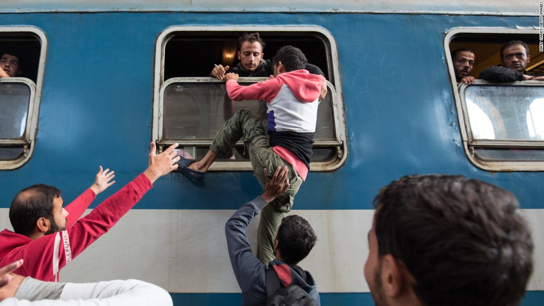 Migrants board a train at Keleti station in Budapest, Hungary, after the station was reopened on Thursday, September 3.