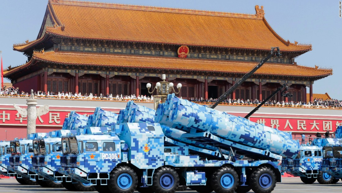 Military vehicles carry missiles past the Tiananmen Gate on September 3.