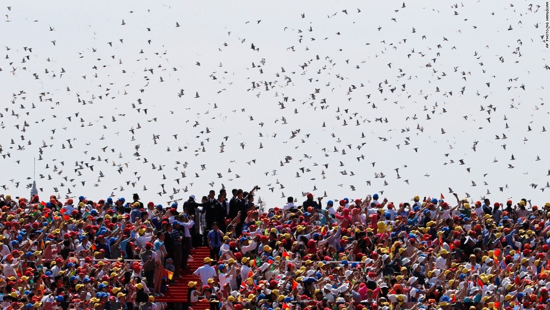 Thousands of doves are released during the parade on September 3.
