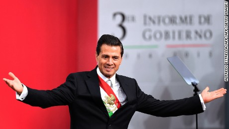 "Mexican President Enrique Pena Nieto gestures after delivering his third annual report at the National Palace in Mexico City on September 2, 2015. Mexico's embattled President Enrique Pena Nieto acknowledged his country's ""outrage"" over a drug kingpin's jailbreak, the presumed massacre of 43 students and other scandals in his state-of-the-nation speech Wednesday. AFP PHOTO/ALFREDO ESTRELLA        (Photo credit should read ALFREDO ESTRELLA/AFP/Getty Images)"