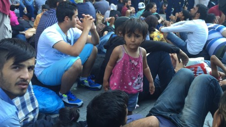 HUNGARY CLOSES BUDAPEST'S MAIN EASTERN RAILWAY STATION, NO TRAINS DEPARTING OR ARRIVING, HUNDREDS OF MIGRANTS WAITING - Large and upset crowds of migrants were being held up from departing from the Keleti train station in Budapest on Tuesday morning, CNN team on the ground witnessed. Hundreds of migrants who had expected to board trains to head on to Austria and Germany instead found the station closed to traffic. They chanted but once they decided to stop, the demo turned into a 'Sit-In' instead.