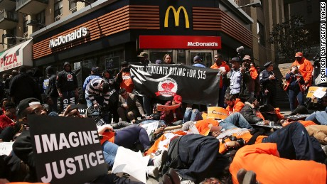 Workers protest at a New York McDonald's in April 2015 to demand a minimum wage of $15 an hour.