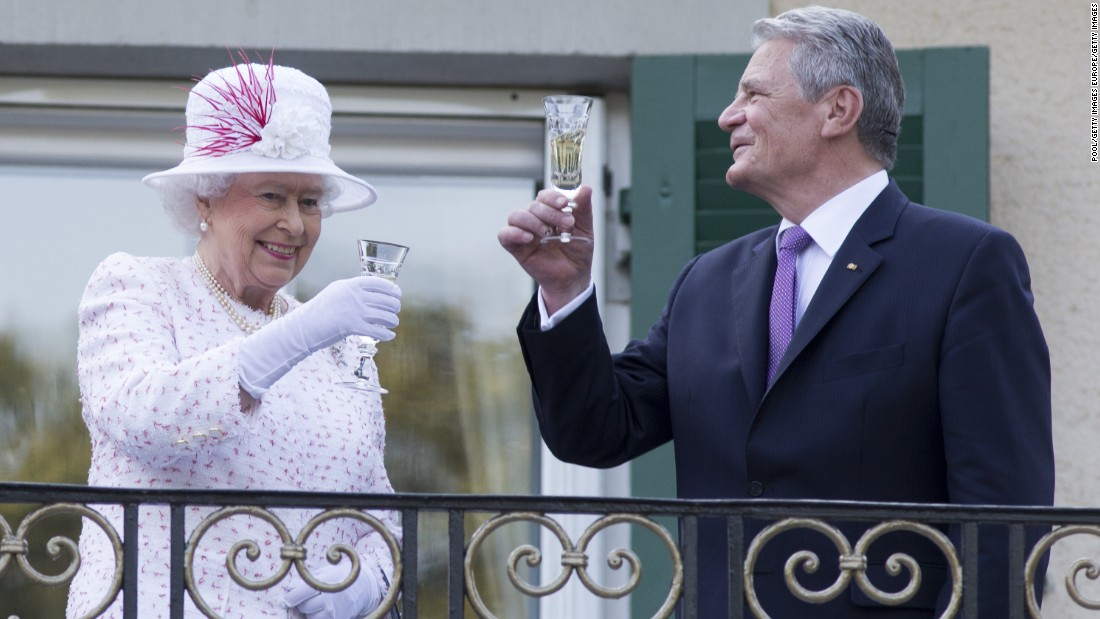 "The Queen raises a glass with the President of Germany, Joachim Gauck, as they attend a garden party at the British Embassy residence on a <a href=""http://edition.cnn.com/2015/06/23/europe/uk-germany-queen-state-visit/"">state visit </a>to the country on June 25, 2015 in Berlin."