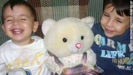 This handout photo courtesy of Tima Kurdi shows a photo of Aylan Kurdi, left, and his brother Galib Kurdi. The body of 3-year-old Syrian Alan Kurdi was found on a Turkish beach after the small rubber boat he, his 5-year old brother Galib and their mother, Rehan, were in capsized during a desperate voyage from Turkey to Greece. The family stated that the spelling of the boys names had been changed by Turkish authorities to Aylan and Galip, but were in fact spelled as Alan and Galib.  (Photo courtesy of Tima Kurdi/The Canadian Press via AP) MANDATORY CREDIT
