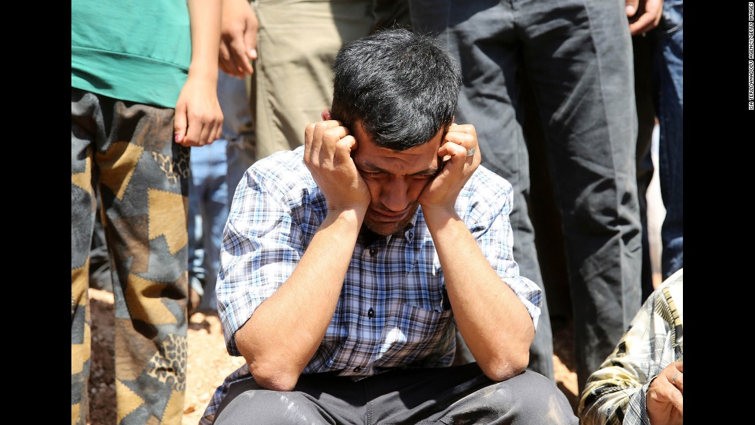 Abdullah Kurdi, the boys' father and widower of Rehen, mourns during the funeral in Kobani on September 4.
