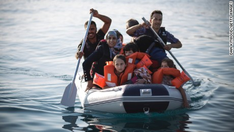 A Syrian family arrives in an inflatable dinghy at Kos on August 30.