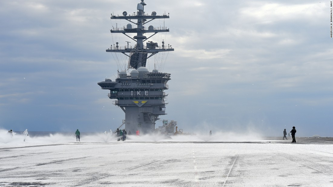 Sailors test the countermeasure washdown system on the flight deck of the Nimitz-class aircraft carrier USS Dwight D. Eisenhower (CVN 69) during sea trials prior to returning to its homeport at Naval Station Norfolk in late August 2015.