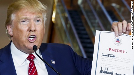 Image #: 39177601    U.S. presidential hopeful Donald Trump holds up a signed pledge during a press availability at Trump Tower in Manhattan, New York September 3, 2015. Trump is expected on Thursday to sign a pledge not to run as an independent candidate if he loses the Republican Party nomination, a party official said, despite earlier refusals to rule out a third-party bid.  REUTERS/Lucas Jackson /LANDOV        TPX IMAGES OF THE DAY
