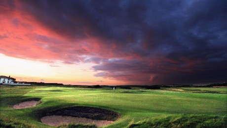 PRESTWICK, SCOTLAND - AUGUST 26: Sunset on a stormy night over the green on the par 4, 14th hole at The Prestwick Golf Club on August 26, 2010 in Prestwick, Ayrshire, Scotland.  (Photo by David Cannon/Getty Images)