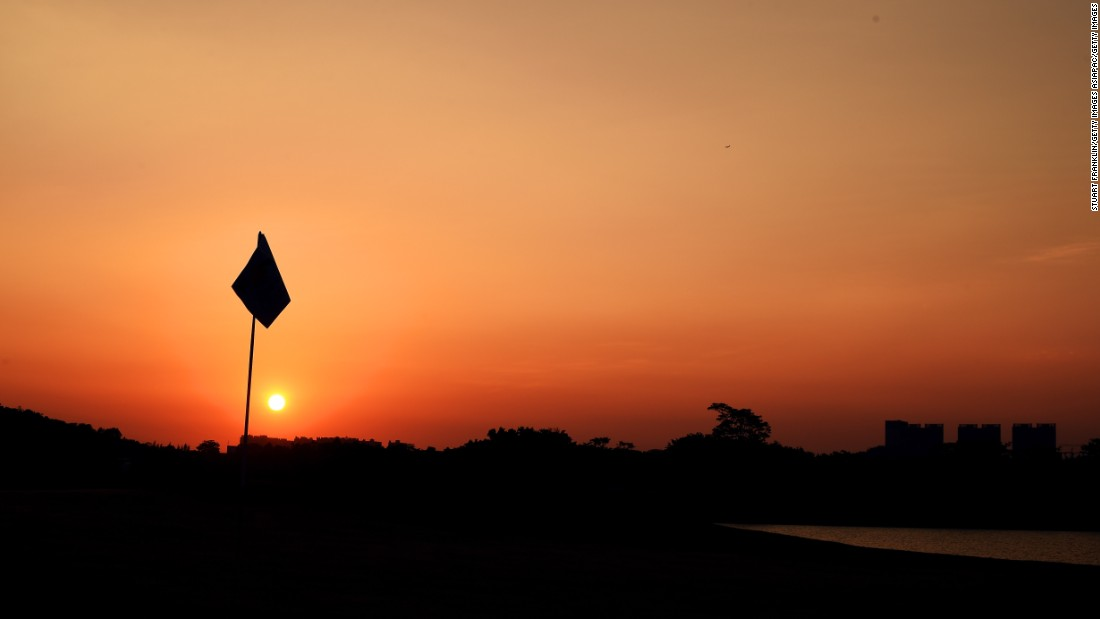 Slightly hazier perhaps, but no less stunning. The sun drops at the Shenzhen International at Genzon Golf Club in Shenzhen, China.