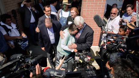 Rowan County clerk Kim Davis, center, hugs her attorney, Matt Staver, with Republican presidential candidate Mike Huckabee, center left, next to her after being released from the Carter County Detention Center, Tuesday, Sept. 8, 2015, in Grayson, Ky.