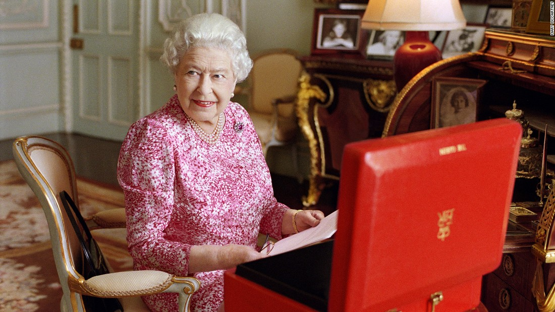 The Queen sits at a desk in Buckingham Palace in July 2015.