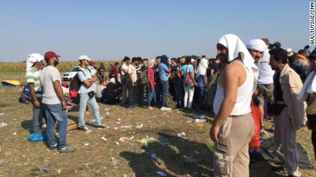 Refugees were told to wait in a field, with no shelter from the elements.