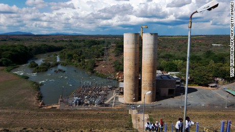 Photo taken on April 12, 2012 shows  the Masinga hydro-electricity power plant at the Masinga dam, approximately 230 kilometres north of  Nairobi, that is part of a series of dams known as the seven-forks dams that are the country's main electricity generators. Only about 18% of Kenyan households have access to power, according to the United Nations Environment Programme, where peak demand for electricity has increased to 1,200MW and is forecasted to reach 15,000MW by 2030. Over-reliance on hydro-generated energy, that supplies 60% of the national requirement, has meant severe gluts in daily supply and expansion countrywide due to changes in climatic patterns that in recent years has seen the eastern Africa region suffer catastrophic droughts owing to numerous failed rains. An ambitious windfarm project on the shores of Lake Turkana in the semi-arid north, the biggest project of its kind in Africa, is expected to provide 300MW of low-cost power to the national grid - equivalent to about 20% of the current installed electricity-generating capacity - combined with the expansion of geothermal electricity generation in the Kenyan rift-valley, where there is now a near-term target of about 1,300MW along with the potential of solar energy in Kenya which has hardly been tapped yet, Kenya could become a zero-emission economy in the field of electricity generation over the coming years by some estimates, says the UNEP . AFP PHOTO/Tony KARUMBA        (Photo credit should read TONY KARUMBA/AFP/GettyImages)