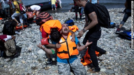 Refugees board rubber rafts for Europe