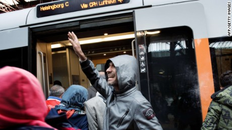 Migrants enter a train with direction to the Swedish town Helsingborg at the central railway station in Copenhagen on September 10, 2015. Denmark's train operator said Thursday it expected rail traffic across the German border to resume later in the day, after police ordered services to be suspended due to an influx of migrants. Police meanwhile announced they were letting refugees travel freely through Denmark without registering if they didn't want to seek asylum there, allowing them to head to Sweden which is the preferred destination of many because of its more welcoming and generous asylum policy.