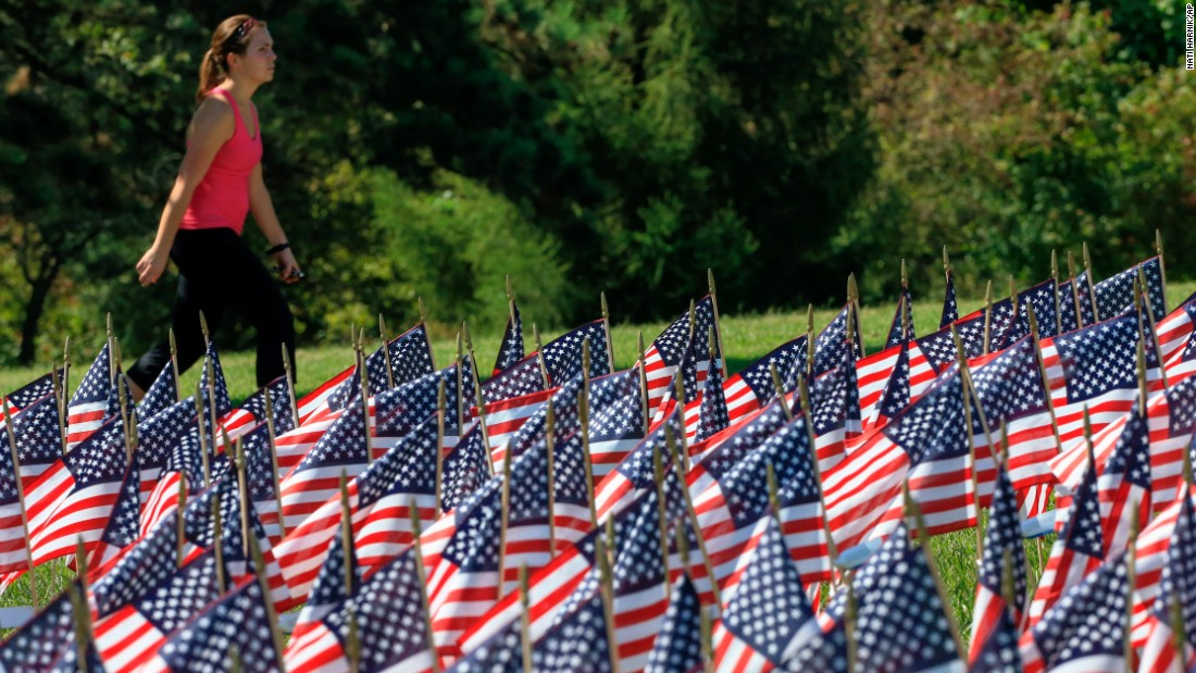 Flags carry the names of the 9/11 victims at Memorial Park in Omaha, Nebraska, on September 10.