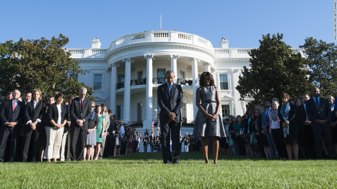 President Barack Obama and first lady Michelle Obama lead a moment of silence on the White House South Lawn at 8:46 a.m. Friday -- the time when the first hijacked plane hit the World Trade Center on 9/11.